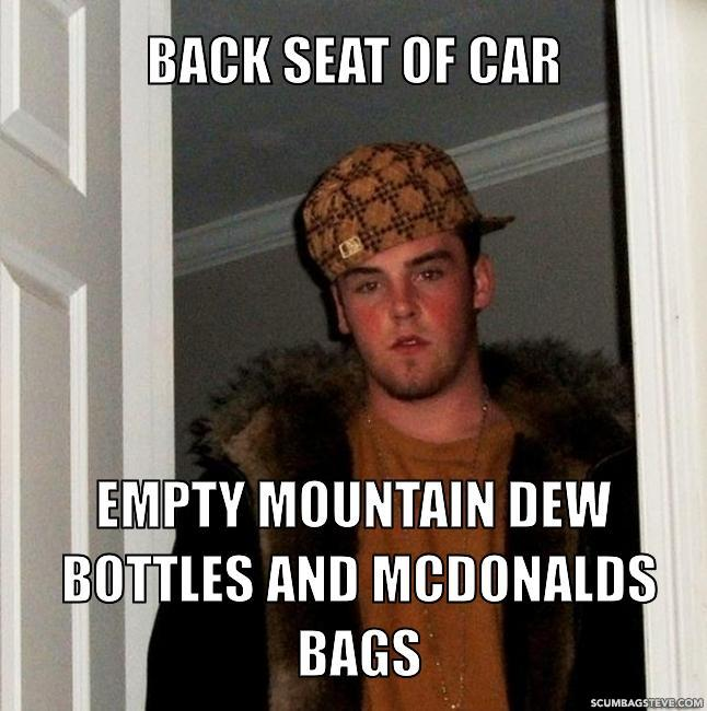 Back seat of car empty mountain dew bottles and mcdonalds bags 4cf525