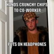 Hands crunchy chips to co worker puts on headphones f76694