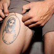 Female jesus tattoo